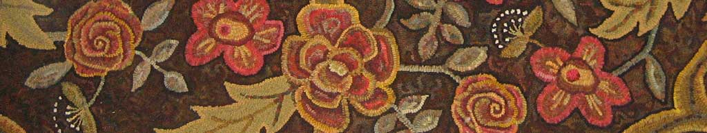 room-sized hooked rug closeup